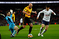 David Pipe of Newport County © looks to clear under pressure from Son Heung-min of Tottenham Hotspur (R). The Emirates FA Cup, 4th round replay match, Tottenham Hotspur v Newport County at Wembley Stadium in London on Wednesday 7th February 2018.<br /> pic by Steffan Bowen, Andrew Orchard sports photography.