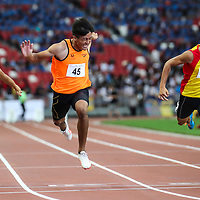 Chong Wei Guan (#45) of Singapore Sports School wins the A Division boys' 100m final. (Photo © Lim Yong Teck/Red Sports)