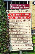 Road signs indicating the direction to various wine producers in Chateauneuf-du-Pape: Verger des Papes, Maison des Vins, La Mule du Pape, La Marmite, Grand Veneur, Clefs d'Or, Cabrieres les Siles, Pierre Usseglio, Clos Saint Andre, Boiron Maurice, des Senechaux, Mont Redon, de la Gardine, Moulin Tacussel  Chateauneuf-du-Pape Châteauneuf, Vaucluse, Provence, France, Europe  Chateauneuf-du-Pape Châteauneuf, Vaucluse, Provence, France, Europe