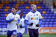 AFC Wimbledon striker Joe Pigott (39) and AFC Wimbledon attacker Adam Roscrow (10) warming up during the EFL Sky Bet League 1 match between AFC Wimbledon and Bristol Rovers at Plough Lane, London, United Kingdom on 5 December 2020.