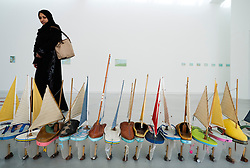 Nautical sculpture with shoes converted to boats by Francis Alys on opening day of the 11th Sharjah Biennial Art festival in United Arab Emirates