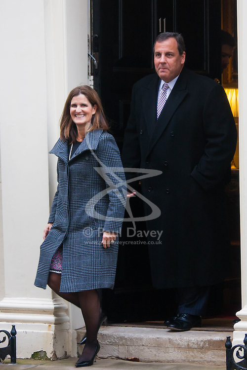 """Downing Street, London, February 3rd 2015. New Jersey Governor and Republican Presidential hopeful Chris Christie accompanied by his wife Mary visits British Chancellor George Osbourne at No. 11 Downing Street, declining to give a press statement but telling the gathered media  """"We had a lot of fun!""""."""