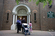 Catholic priest bids goodbye to parish family after morning Mass at St. Lawrence's Catholic church in Feltham, London.