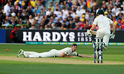 England's Craig Overton looks on as Australia's Steve Smith goes through for a run during day one of the Ashes Test match at the Adelaide Oval, Adelaide.