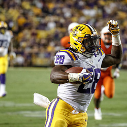 Sep 23, 2017; Baton Rouge, LA, USA; LSU Tigers running back Darrel Williams (28) runs against the Syracuse Orange during the third quarter of a game at Tiger Stadium. Mandatory Credit: Derick E. Hingle-USA TODAY Sports
