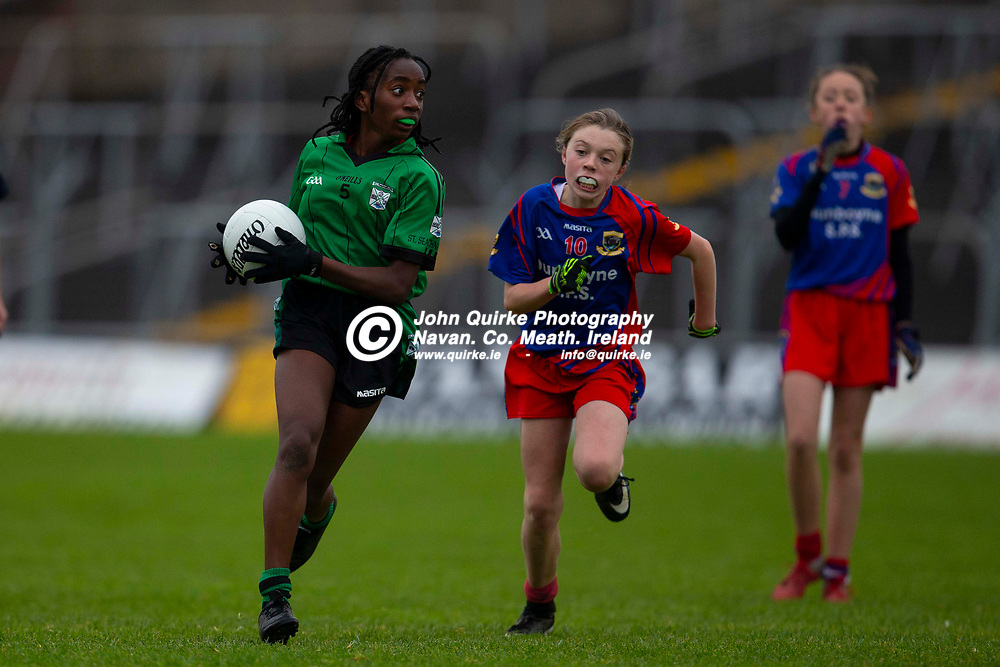 16/11/2019, Cumann na mBunscol Primary Schools Finals at Pairc Tailteann<br /> Game 5: Girls Division 1 Football Final.<br /> St Seachnalls NS (Dunshaughlin) vs Dunboyne SPS<br /> Joy Osas (St Seachnalls NS) & Aoife Donohoe (Dunboyne NS)<br /> Photo: David Mullen / www.quirke.ie ©John Quirke Photography, Unit 17, Blackcastle Shopping Cte. Navan. Co. Meath. 046-9079044 / 087-2579454.<br /> ISO: 1250; Shutter: 1/1250; Aperture: 3.2; <br /> File Size: 2.8MB