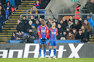Crystal Palace midfielder Max Meyer (7) and Crystal Palace forward Wilfried Zaha (11) form a small wall for Grimsby Town's defender Reece Hall-Johnson (2) free-kick during The FA Cup 3rd round match between Crystal Palace and Grimsby Town FC at Selhurst Park, London, England on 5 January 2019.