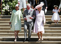 (Left-right) Doria Ragland, mother of the bride, the Prince of Wales and the Duchess of Cornwall walk down the steps of St George's Chapel in Windsor Castle after the wedding of Prince Harry and Meghan Markle.