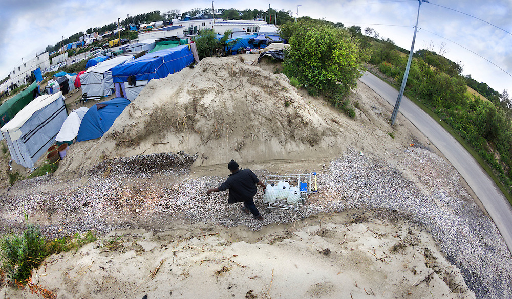 The water carrier. The Jungle, Calais,  northern France.
