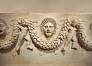 """Close up picture of Roman relief sculpted Sarcophagus of Garlands, 2nd century AD, Perge. This type of sarcophagus is described as a """"Pamphylia Type Sarcophagus"""". It is known that these sarcophagi garlanded tombs originated in Perge and manufactured in the sculptural workshops of Perge. Antalya Archaeology Museum, Turkey.. Against a warm art background.<br /> <br /> If you prefer to buy from our ALAMY STOCK LIBRARY page at https://www.alamy.com/portfolio/paul-williams-funkystock/greco-roman-sculptures.html . Type -    Antalya    - into LOWER SEARCH WITHIN GALLERY box - Refine search by adding a subject, place, background colour, etc.<br /> <br /> Visit our ROMAN WORLD PHOTO COLLECTIONS for more photos to download or buy as wall art prints https://funkystock.photoshelter.com/gallery-collection/The-Romans-Art-Artefacts-Antiquities-Historic-Sites-Pictures-Images/C0000r2uLJJo9_s0"""
