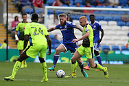 Aron Gunnarsson of Cardiff city © challenges Paul McShane of Reading (5). EFL Skybet championship match, Cardiff city v Reading at the Cardiff city stadium in Cardiff, South Wales on Saturday 27th August 2016.<br /> pic by Andrew Orchard, Andrew Orchard sports photography.