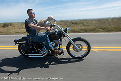"""""""Moonshiner Josh"""" Owens with his dog """"Cutie Pie"""" on their 2005 Harley-Davidson Softail on A1A along the ocean south of Flagler Beach during Daytona Beach Bike Week 2015. FL, USA. March 13, 2015.  Photography ©2015 Michael Lichter."""