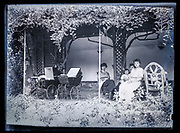 young mothers with baby strollers and toddler in garden relaxing France ca 1920s