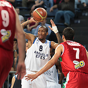 Anadolu Efes's Terence Kinsey (C) during their Turkish Basketball League Play Off match Anadolu Efes between Pinar Karsiyakaat Sinan Erdem Arena in Istanbul, Turkey, Sunday, May 06, 2012. Photo by TURKPIX