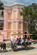 A horse carriage tour passes the Palmer House historic inn boarded up in preparation for Hurricane Irma on the Battery September 8, 2017 in Charleston, South Carolina. Imra is expected to spare the Charleston area but hurricane preparations continue as Irma leaves a path of destruction across the Caribbean.