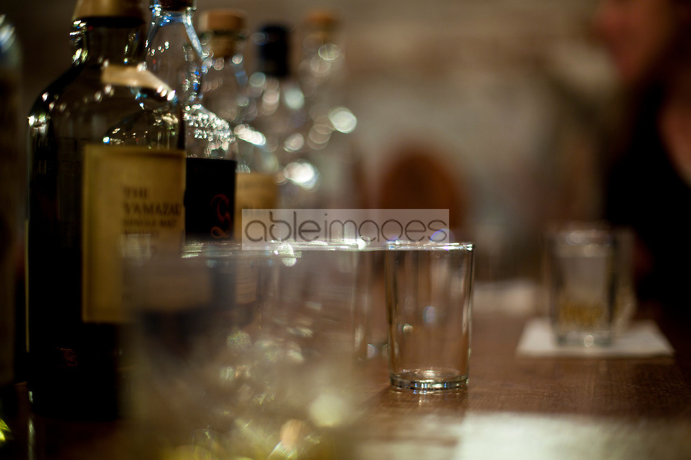 Spirits Bottles and Drinking Glasses on Bar Counter