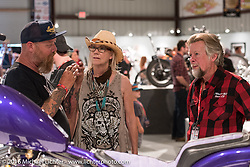 Bill Dodge with Donna Maupin and Arlin Fatland of 2-Wheelers on the Industry party night for Michael Lichter's tattoo themed Skin & Bones Motorcycles as Art exhibition at the Buffalo Chip during the annual Sturgis Black Hills Motorcycle Rally.  SD, USA.  August 7, 2016.  Photography ©2016 Michael Lichter.