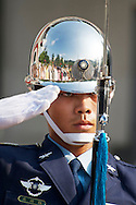 A Taiwanese soldier salutes at the Martyrs' Shrine.
