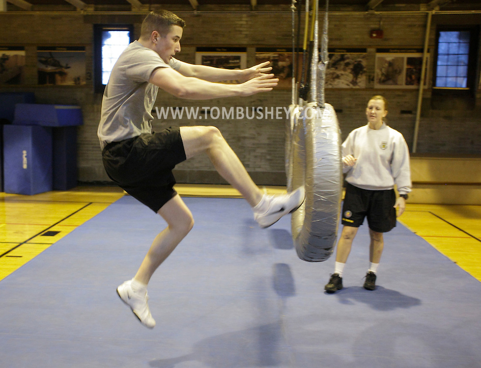 A cadet approaches the Thru the Tires obstacle during the Indoor Obstacle Course Test in Hayes Gym at the U.S. Military Academy at West Point on Feb. 9, 2010.