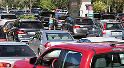 Patrons wait in line for gas at the Costco store on Oct. 5, 2016 in Altamonte Springs, FL, USA, as central Floridians prepare for the anticipated strike of Hurricane Matthew.Photo by Joe Burbank/Orlando Sentinel/TNS/ABACAPRESS.COM