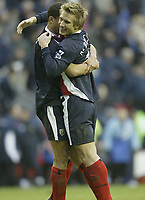 Photo: Aidan Ellis.<br /> Wigan Athletic v West Bromwich Albion. The Barclays Premiership. 15/01/2006.<br /> West Brom goal scorer Martin Albrechstan celebrates victory at the end with Curtis Davis