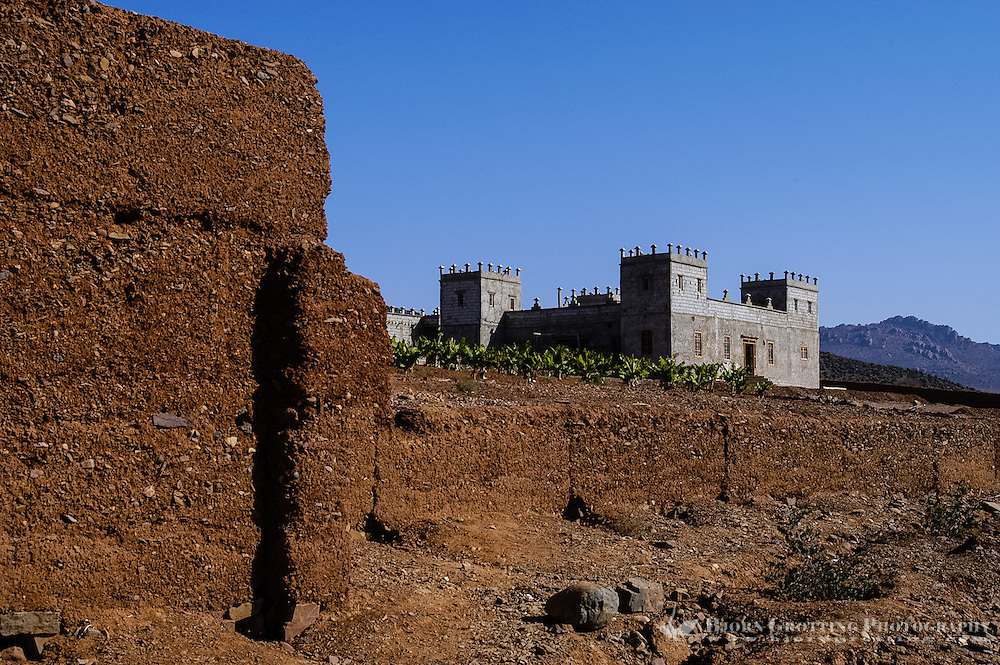Old and new buildings in the arid desert landscape south of Agadir, Morocco.