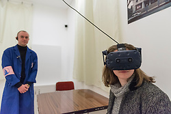 """© Licensed to London News Pictures. 03/03/2020. LONDON, UK. A visitor wears a virtual reality headset to experience """"The Eternal Wave"""", 2020, by Cao Fei.  Preview of """"Blueprints"""" by Cao Fei, a Chinese multi-media artist and filmmaker, based in Beijing.  The exhibition is the artist's first large-scale solo show in the UK, features works from 2006-2020 including her first virtual reality work. The show takes place at the Serpentine Gallery 4 March to 17 May 2020.  Photo credit: Stephen Chung/LNP"""