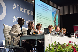 12 December 2019, Madrid, Spain: Isaiah Toroitich from ACT Alliance introduces a side-event on Breaking new ground: Advancing loss and damage governance and finance mechanisms, at COP25.
