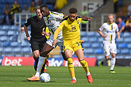 Marcus Browne (10) of Oxford United battles with Lucas Akins (10) of Burton Albion  during the EFL Sky Bet League 1 match between Oxford United and Burton Albion at the Kassam Stadium, Oxford, England on 25 August 2018.