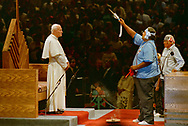 Pope John Paul II made his historic tour to the United States, September 10-18, 1987, visiting Miami, Florida; Columbia, SC; New Orleans, LA; San Antonio, TX, Phoenix, AZ, Los Angeles, CA; Monterrey, CA, San Francisco, CA, and Detroit, MI. <br /> <br /> Pope John Paul II receiving a Native American blessing. <br /> Phoenix, AZ.
