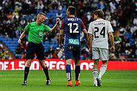 Real Madrid´s Asier Illarramendi and Eibar´s Borja Fernandez and referee Alejandro Jose Hernandez during 2014-15 La Liga match between Real Madrid and Eibar at Santiago Bernabeu stadium in Madrid, Spain. April 11, 2015. (ALTERPHOTOS/Luis Fernandez)