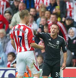 10.09.2011, Britannia Stadium, Stroke-on-Trent, ENG, PL, Stoke City FC vs Liverpool FC, im Bild Liverpool's Craig Bellamy clashes with Stoke City's Ryan Shawcross during the Premiership match at the Britannia Stadium. EXPA Pictures © 2011, PhotoCredit: EXPA/ Propaganda Photo/ David Rawcliff +++++ ATTENTION - OUT OF ENGLAND/GBR+++++