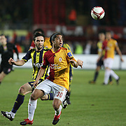 Galatasaray's Giovani Dos Santos Ramirez (R) and Fenerbahce's Gokhan GONUL (L) during their Turkish superleague soccer derby match Galatasaray between Fenerbahce at the AliSamiYen Stadium at Mecidiyekoy in Istanbul Turkey on Sunday, 28 March 2010. Photo by TURKPIX
