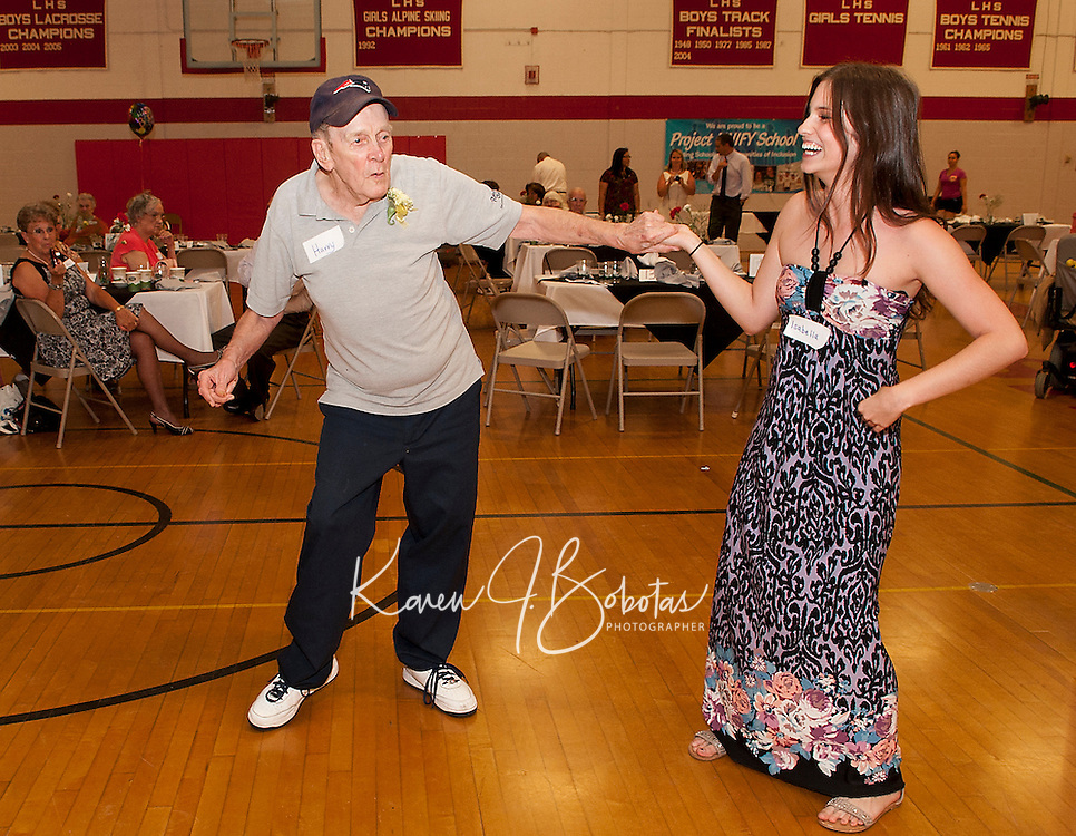 Harry Yourison delights Isabella Price with a few of his own dance moves during the Senior Senior Dance Thursday evening at Laconia High School.  (Karen Bobotas/for the Laconia Daily Sun)
