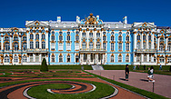 Peterhof, Russia -- July 21, 2019.  Tourist takes a photo with the summer palace in Peterhof as the background.