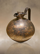 Phrygian bronze trefoil spouted jug from Gordion . Phrygian Collection, 8th century BC - Museum of Anatolian Civilisations Ankara. Turkey. Against an art background .<br /> <br /> If you prefer you can also buy from our ALAMY PHOTO LIBRARY  Collection visit : https://www.alamy.com/portfolio/paul-williams-funkystock/phrygian-antiquities.html  - Type into the LOWER SEARCH WITHIN GALLERY box to refine search by adding background colour, place, museum etc<br /> <br /> Visit our CLASSICAL WORLD PHOTO COLLECTIONS for more photos to download or buy as wall art prints https://funkystock.photoshelter.com/gallery-collection/Classical-Era-Historic-Sites-Archaeological-Sites-Pictures-Images/C0000g4bSGiDL9rw