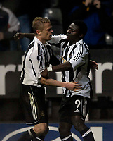 Photo: Jed Wee/Sportsbeat Images.<br /> Newcastle United v Zulte-Waregem. UEFA Cup, 2nd Leg. 22/02/2007.<br /> <br /> Newcastle's Damien Duff (L) celebrates with goalscorer Obafemi Martins.
