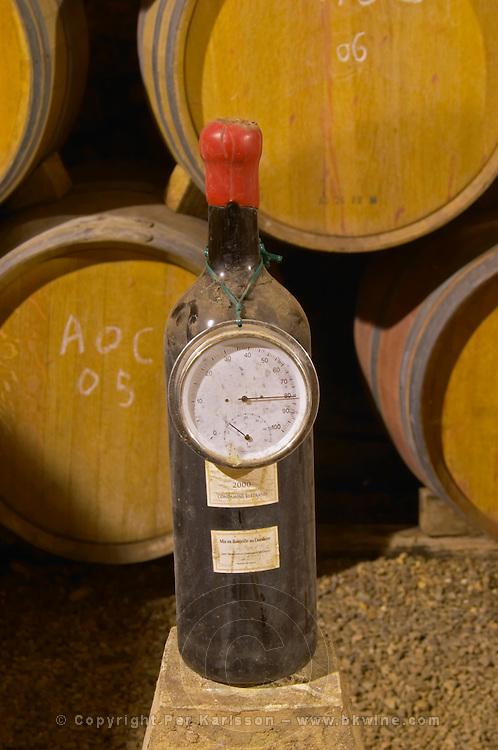 Chateau la Condamine Bertrand. Pezenas region. Languedoc. Barrel cellar. Thermometer. Hygrometer. France. Europe. Bottle.