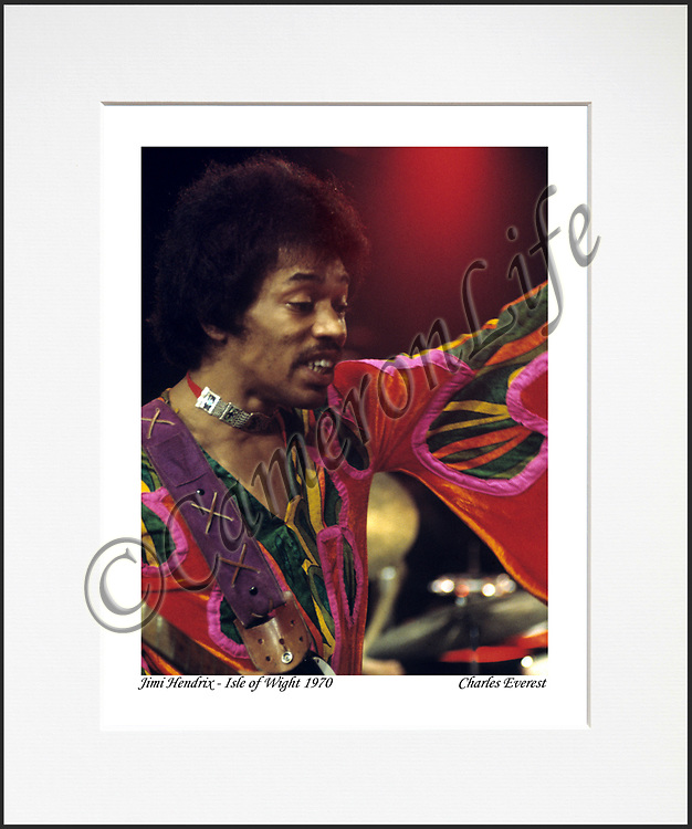 """Jimi Hendrix - An affordable archival quality matted print ready for framing at home.<br /> Ideal as a gift or for collectors to cherish, printed on Fuji Crystal Archive photographic paper set in a neutral mat (all mounting materials are acid free conservation grade). <br /> The image (approx 6""""x8"""") sits within a titled border. The outer dimensions of the mat are approx 10""""x12""""."""