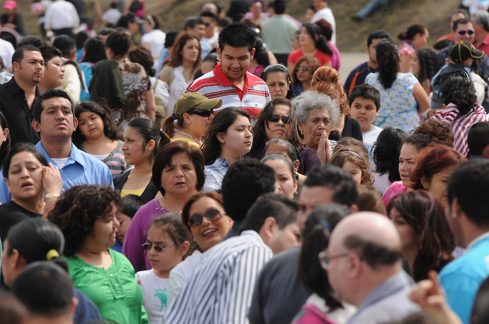 Several thousand Catholics fill the parking lot of Most Blessed Trinity Parish in Waukegan during a mass attended by Francis Cardinal George following a Living Way of the Cross procession.
