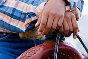 08 SEPTEMBER 2007 -- FT. DEFIANCE, AZ: A competitor's hands on her saddle at the All Women Rodeo in the Dahozy Stampede Rodeo Arena in Ft. Defiance, AZ, on the Navajo Indian Reservation. It was the first all women's rodeo on the Navajo Indian Reservation.  Photo by Jack Kurtz/ZUMA Press