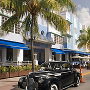 Park Central Hotel on Ocean Drive in South Beach, Miami. This art deco hotel was designed by Henry Hohauser in 1937. A vintage car from the 1930's is parked outside.