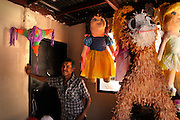 Sergio Calzadillas takes a break from making pinatas in Nogales, Sonora, Mexico.  The shop is located about two blocks from the border fence at Nogales, Arizona, USA.