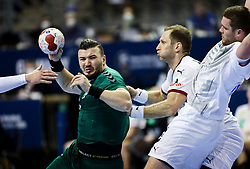 Aaladine Hadidi of Algeria in action during handball match between National Teams of Algeria and Germany at Day 3 of IHF Men's Tokyo Olympic  Qualification tournament, on March 14, 2021 in Max-Schmeling-Halle, Berlin, Germany. Photo by Vid Ponikvar / Sportida