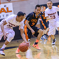 012915       Cable Hoover<br /> <br /> Gallup Bengal Cody Tabaha (13) steals the ball away from Aztec Tiger Jared Diswood (2) Thursday at Gallup High School.
