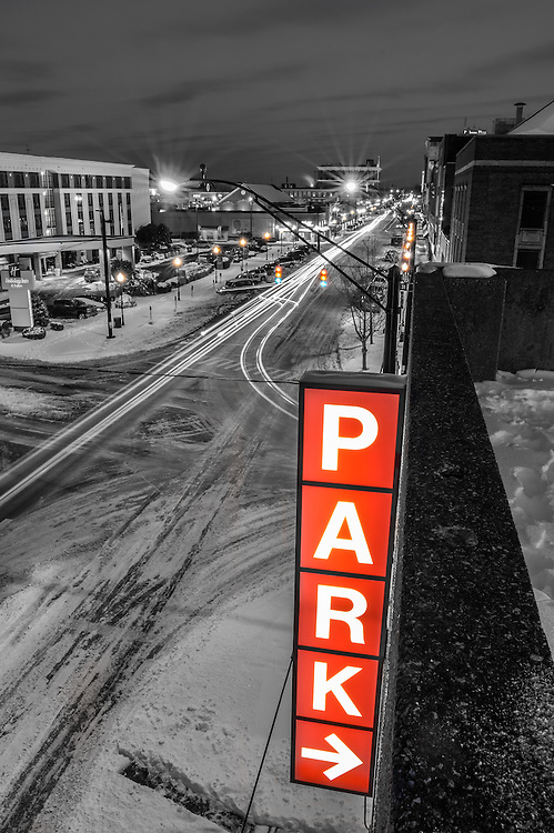 Long exposure of traffic in Pullman Square in downtown Huntington, West Virginia at night after a snow storm.