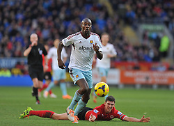 West Ham United's Carlton Cole fouls Cardiff City's Mark Hudson and leaves  him on the floor.  - Photo mandatory by-line: Alex James/JMP - Tel: Mobile: 07966 386802 11/01/2014 - SPORT - FOOTBALL - Cardiff City Stadium - Cardiff - Cardiff City v West Ham United - Barclays Premier League
