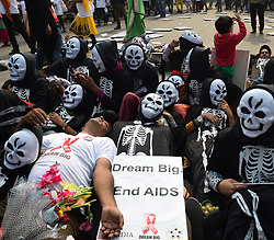 Dec. 1, 2015 - New Delhi, India - Members of AIDS Healthcare Foundation and National Coalition of People Living with HIV in India stage a demonstration demanding more budgetary allocations in health sector particularly for AIDS on World AIDS Day, at Jantar Mantar in New Delhi, India.  (Credit Image: © Xinhua via ZUMA Wire)
