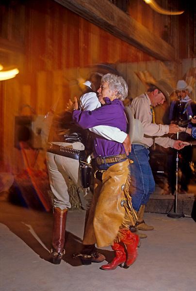 An older couple dancing in western wear