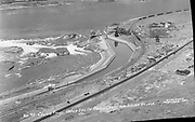 9305-B7024. Bird's-eye view of Celilo village about 1928. The gas station on the east end of town hasn't been built yet. The road is paved but the white line hasn't been painted yet, that happened in 1933. On the lower left is the 400 foot parking space that Frank Seufert donated in May 1925. In the lower right is the Celilo General Store.
